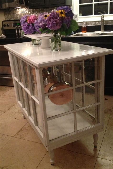 Kitchen island made out of old windows!! LOVE!   Pretty