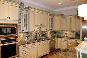 Kitchen backsplash ideas white cabinets brown countertop for Kitchen colors with white cabinets with hand drawn wall art