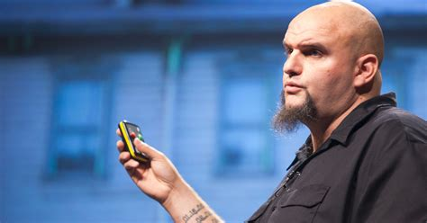 tattooed head shaven straight talking mayor