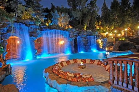 Natural Rock Swimming Pool Designs Ideas With Lighting Decoration