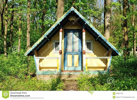 small wooden house abandoned   forest stock photo