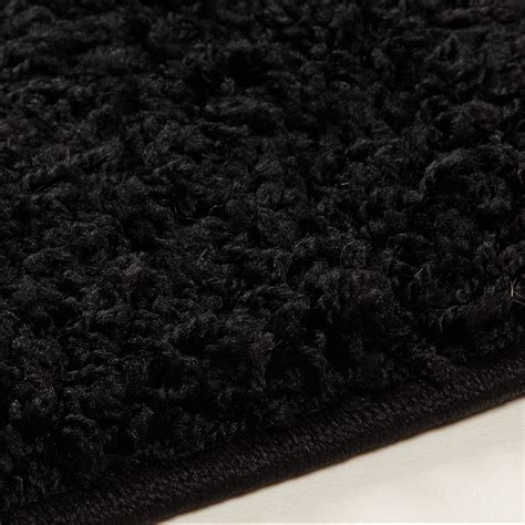 tapis shaggy noir de salon vasco