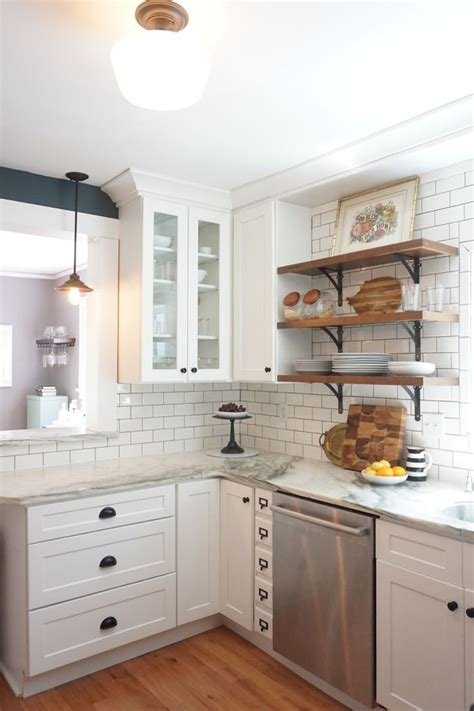 vintage kitchen remodel white shaker cabinets marble countertops white subway tile  open