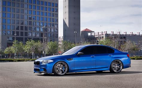 Bmw Blue Car Buildings Iphone Wallpaper
