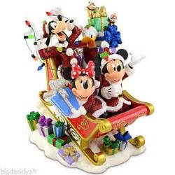 new disney world parks mickey and minnie santa sleigh figurine