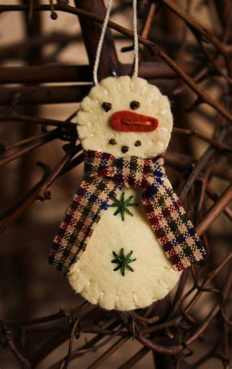 items similar  tiny snowman felt brooch  ornament