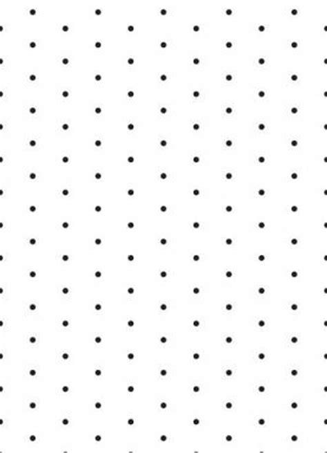 Papel de parede poá com fundo branco e bolinhas pretas em