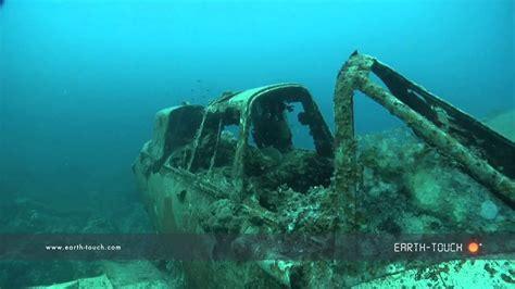 divers explore sunken war plane youtube
