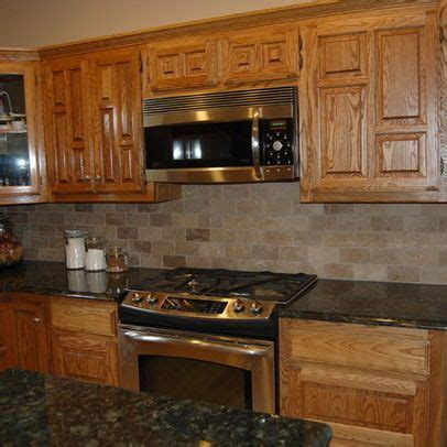 kitchen backsplash pictures with oak cabinets glass tile backsplash with oak cabinets search