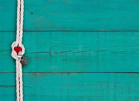 red heart  lock hanging  white rope border