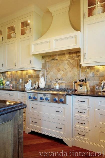 hanging cabinets in kitchen painted kitchen with alder island traditional calgary 4135