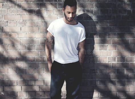 bearded man  tattoo wearing blank white tshirt