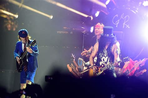 Axl Rose to Replace AC/DC's Lead Singer for Postponed Tour ...