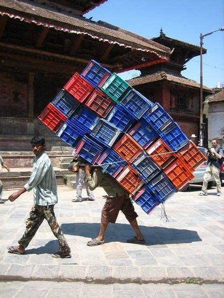 man carrying  usual load  durbar square p photo