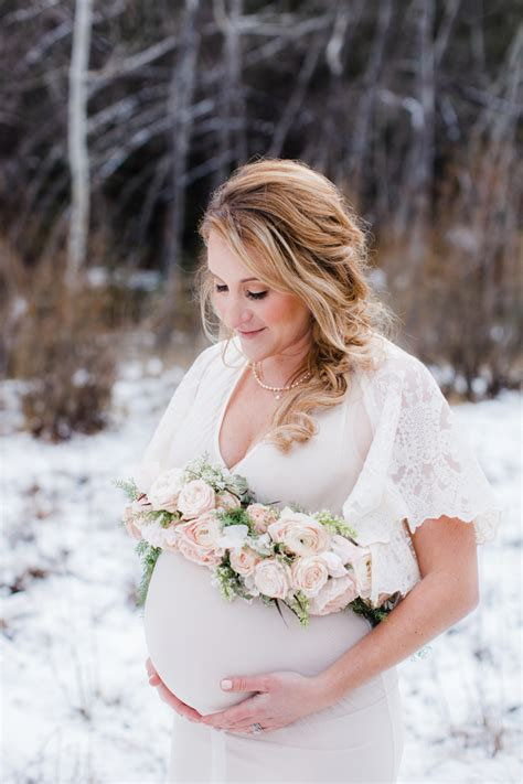 snowy mountain maternity shoot rustic baby chic