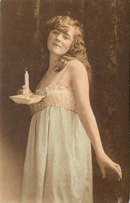 girl facing left, looking forward, hold candle in right