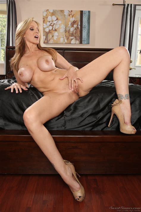 Beautiful Blonde Milf Is Slowly Getting Naked Photos