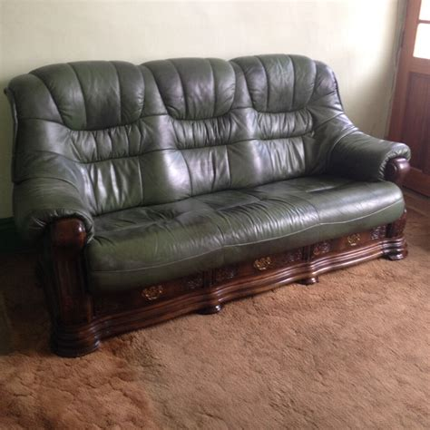 Sofa With Wooden Frame by Green Leather Sofa And Armchair On Wooden Frame With