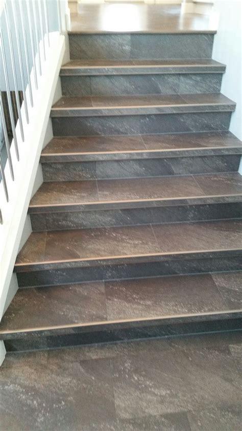luxury vinyl tile installed  custom insert stair