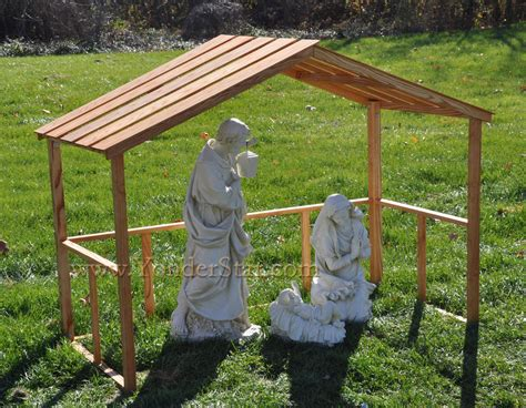 outdoor nativity holy family with wooden manger