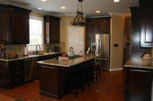 sunset trading kitchen island kraftmaid montclair cherry deason traditional kitchen by lowes of indian