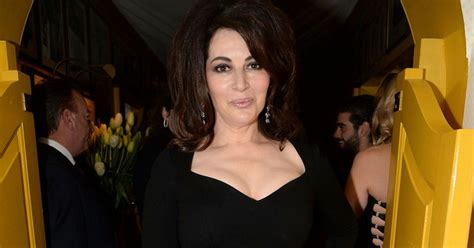 A Pouting Nigella Lawson Is All Cleavage And Big Hair At