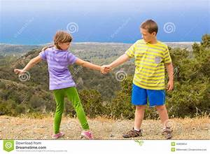 Boy And Girl Holding Hands Stock Photo - Image: 40809654