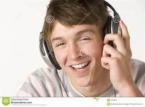 Teenage Boy Listening To Music On Headphones Stock Image ...
