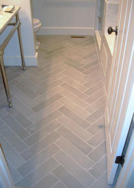 bathroom flooring light tile in herringbone pattern