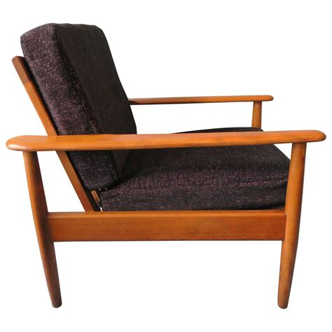 teak lounge chair with speckled cushions mid