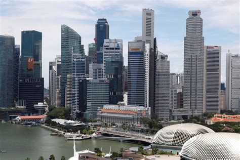 Poll finds Singapore divided over prospect of third ...