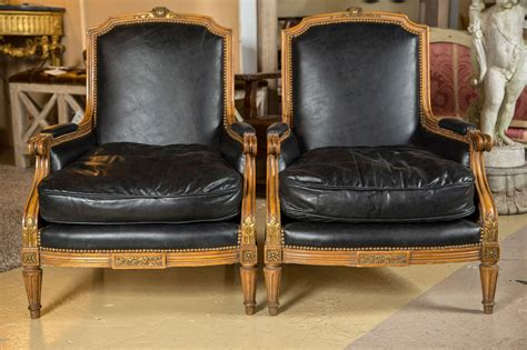 Pair Of Louis Xvi Style Worn Leather Bergere Chairs