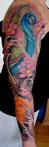 Peacock and Flower Sleeve by Johan Finne: TattooNOW