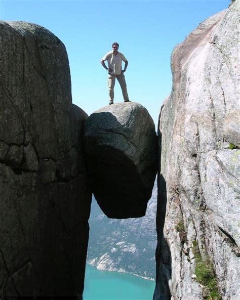 Kjeragbolten a rock balanced between two cliffs in Norway ...