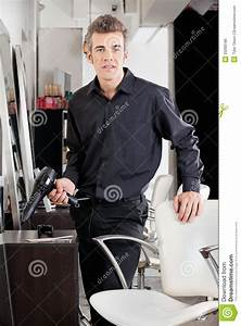Confident Male Hairstylist With Blower Royalty Free Stock ...