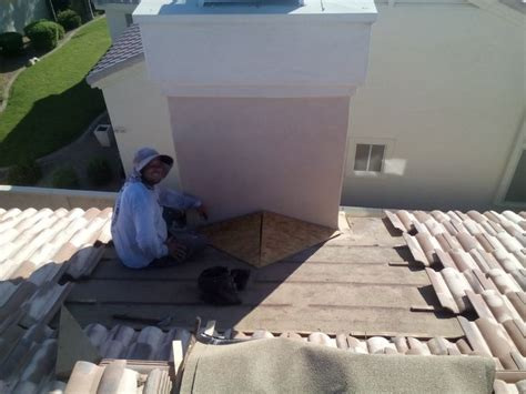chimney cricket installation on tile roof in scottsdale