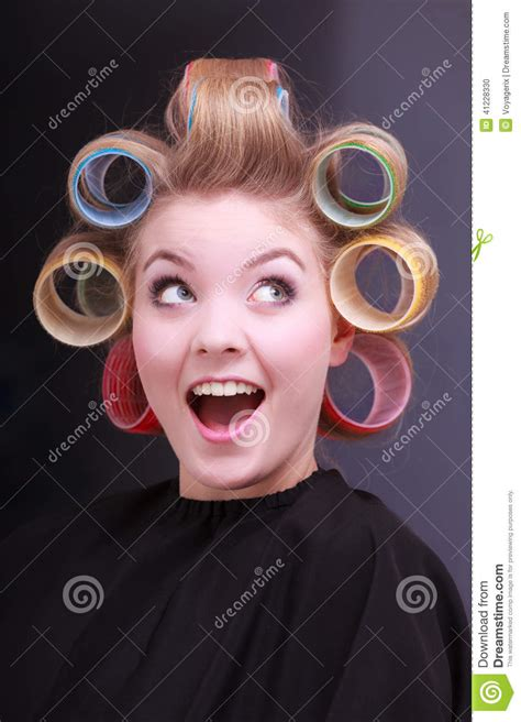 funny cheerful blond girl hair curlers rollers