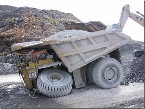 A Caterpillar 797 Mining Truck costs $3.4 million, weighs ...