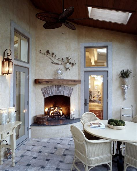 wonderful outdoor stucco fireplace  red brick fence top