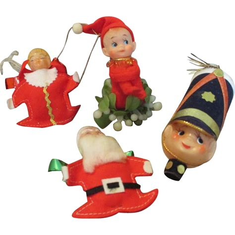 group of 5 vintage christmas ornaments and figures from