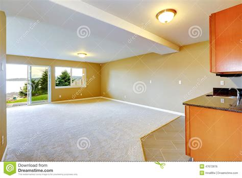 types of floor coverings for kitchens spacious family room with kitchen cabinets stock photo