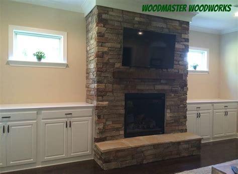 custom built cabinets beside fireplace yelp
