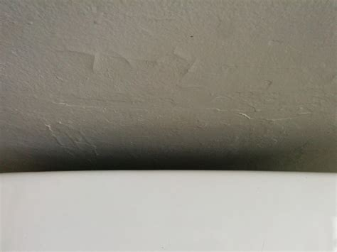 paint with hairline cracks all over bathroom drywall