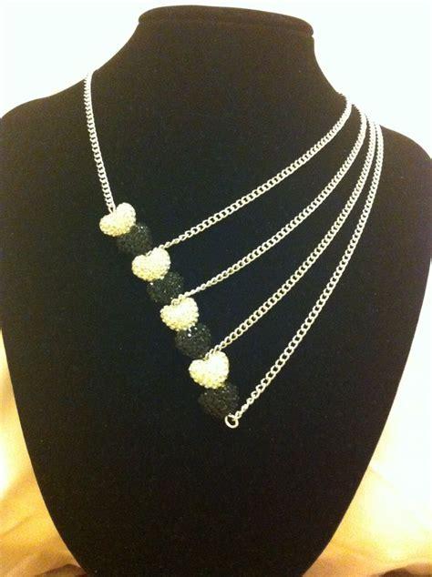 silverblack asymmetrical necklace jewelry design