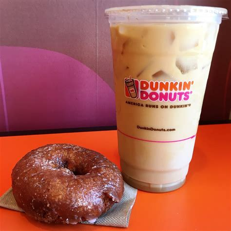 This is not a fan favorite for everyone, but if you enjoy almond joy candy bars, you will love these two flavors. dunkin' donuts caramel swirl iced coffee with cream