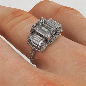 6.00 Carat Emerald Cut Three Stone Diamond Platinum Halo ...