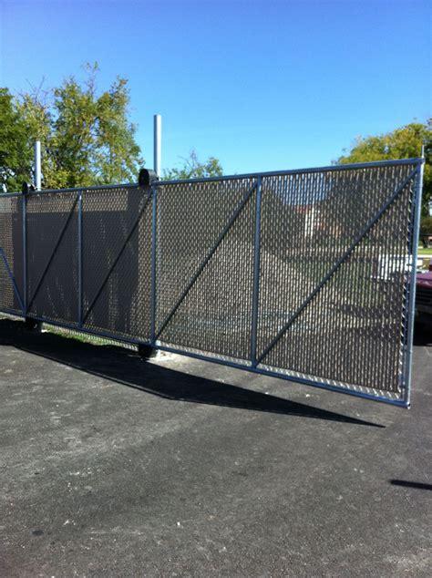 custom chain link auto gate  fabric installed