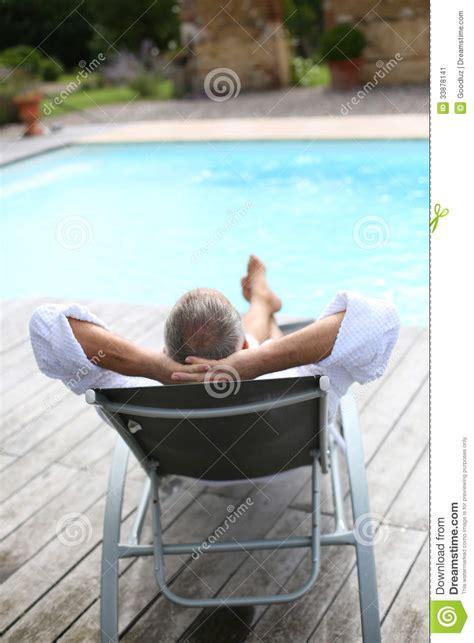 sleeping near pool stock image image 33878141
