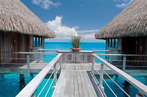tahitis iconic  water bungalows   years