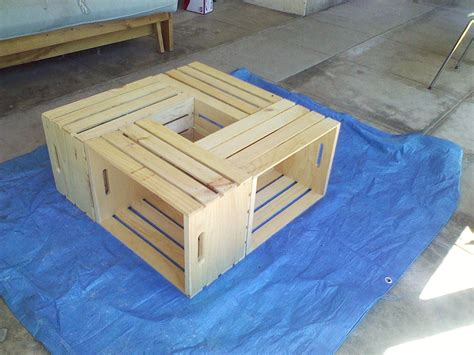 Like wooden pallets, the coffee table wine crates are a delightful resource for creating a table from scratch. ...but, I digress...: Wooden Crate Coffee Table - Day 2